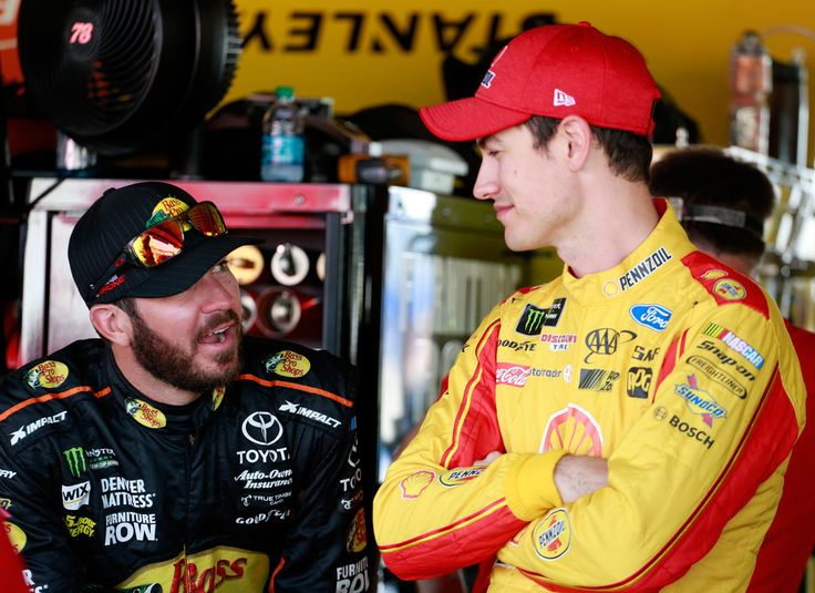 Joey Logano Photos - Martin Truex Jr., driver of the #78 Bass Pro Shops/TRACKER BOATS Toyota, talks with Joey Logano, driver of the #22 Shell Pennzoil Ford, during practice for the Monster Energy NASCAR Cup Series Toyota Owners 400 at Richmond International Raceway on April 28, 2017 in Richmond, Virginia. - Richmond International Raceway - Day 1