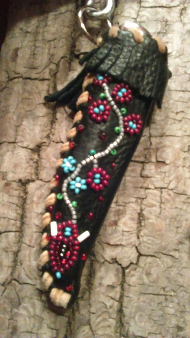 Knife case with Traditional Metis beadwork design on leather and Moosehide