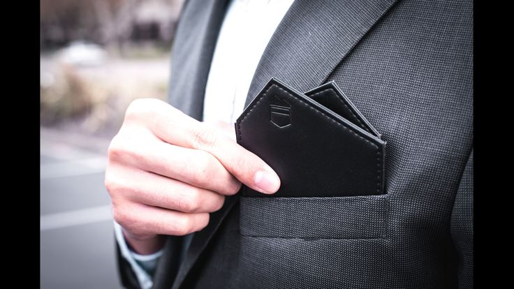 Wingtip Wallet is redefining pocket square rules. Introducing the world's first traditional bi-fold pocket square wallet.