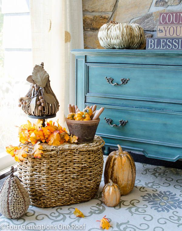 Love this fall entryway with the large basket and pumpkins.  What a fun way to greet your guests this season!
