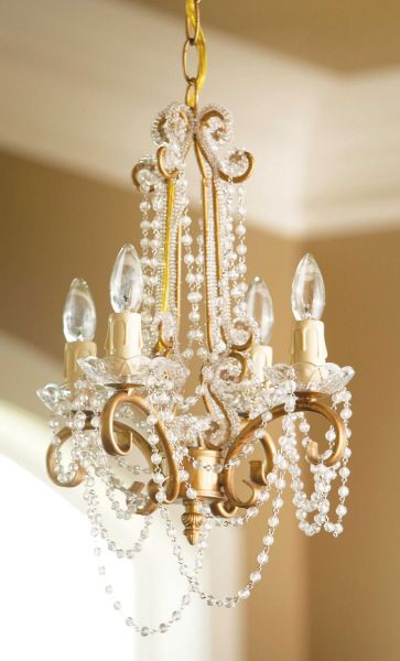 Penelope is the supermodel of the ShopWildThings Gold Chandelier line-up. Dripping with PERFECT acrylic crystal beads, she's by far the most elegant and refined of her peers. This is THE perfect chande