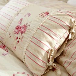 Pillow with stripes, floral, lace and ties.  Easy to make, pretty for accent in girls' rooms