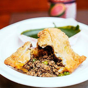 From Vik's Chaat Corner, in Berkeley, California, these pastries have a crisp, thin crust and a spicy lamb filling (keema) mixed with a few sweet peas. They're served with spicy cilantro-mint chutney.