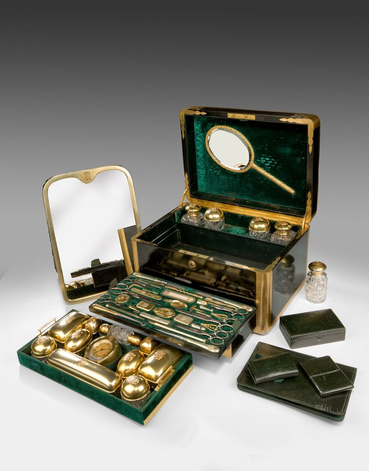SILVER GILT LADIES DRESSING CASE BY JENNER AND KNEWSTUB   Date: c1868 Height: 9.5 ins / 24.13 cms Width: 14.75 ins / 37.47 cms Depth: 11 ins / 27.94 cms  The top opens to reveal fifteen various silver gilt and hobnail cut glass jars, and boxes which are hallmarked London 1866 &1868, with the makers mark AB & JB, -