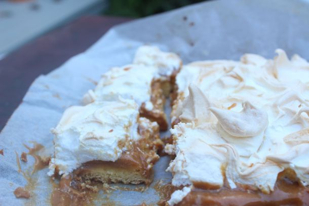 Salted caramel meringue cake slice - more than a slice, almost a cake! Biscuit base, salted caramel filling, meringue topping. Yum. Recipe on my blog.