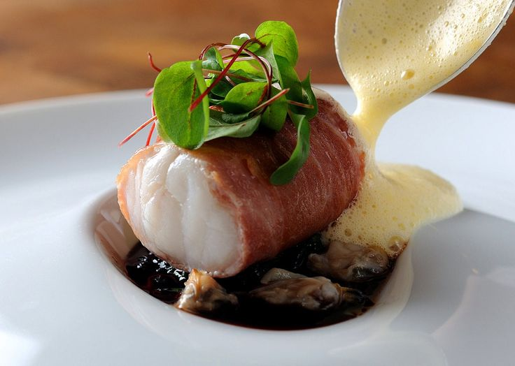 Monkfish wrapped in Parma ham, with red wine jus, lemon sabayon and cockles - Recipe: Chris Horridge - See more at: http://www.greatbritishchefs.com/recipes/monkfish-wrapped-in-parma-ham-cockles#sthash.AFtX8TqB.dpuf