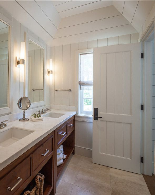 craftsman style bathroom boasts vertical groove paneling layered over horizontal groove paneling used as a backdrop
