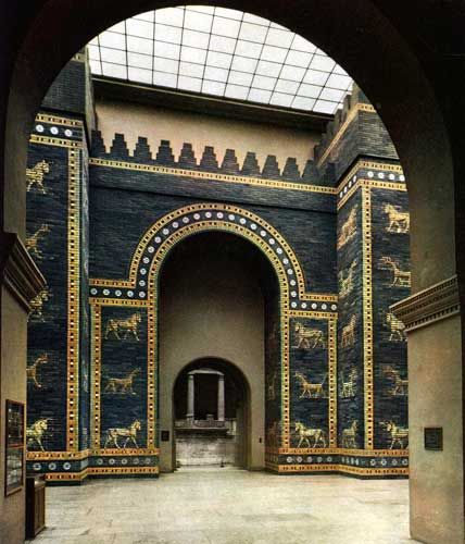 """PERSIAN ART (IRAN) Ishtar Gate from Babylon, Iraq c. 575 B.C. Glazed brick. Jewel-like concentration of ornamental design. Repertory of forms known as """"animal style."""" High relief. Hoofs project off surface of gate. Rosette pattern. Reconstruction was built out of material excavated from 1902 to 1914 - 45' of the gate was uncovered.  Currently stands 47' high and 100' wide. """"Insitu"""" - not in original site. LOCATION: VORDERASIATISCHES MUSEUM, STAATLICHE MUSEUM, BERLIN"""