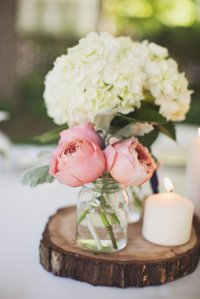 15 Unique wedding reception ideas on a budget - Simple wedding centerpieces in mason jar and use slice of wood + candle to create rustic romantic looks