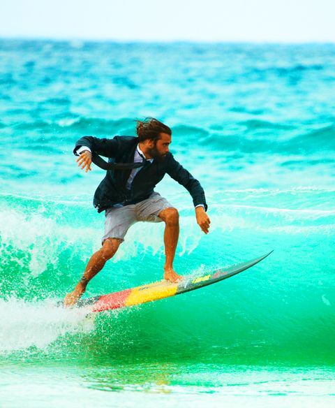 Guy surfing in shorts, tie and blazer this cracks me up!  Nothing like a day at the office to clear your head!