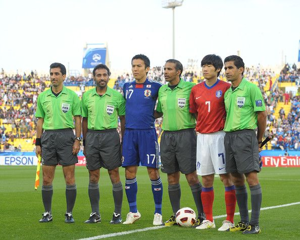 Referee Khalif AL Ghamdi (3rd R) of Saudi Arabia, Makoto Hasebe (3nd L) of Japan and Ji-Sung Park (2nd L) of Korea pose with other match officials prior toduring the AFC Asian Cup Semi Final match between Japan and South Korea at Al-Gharafa Stadium on January 25, 2011 in Doha, Qatar.