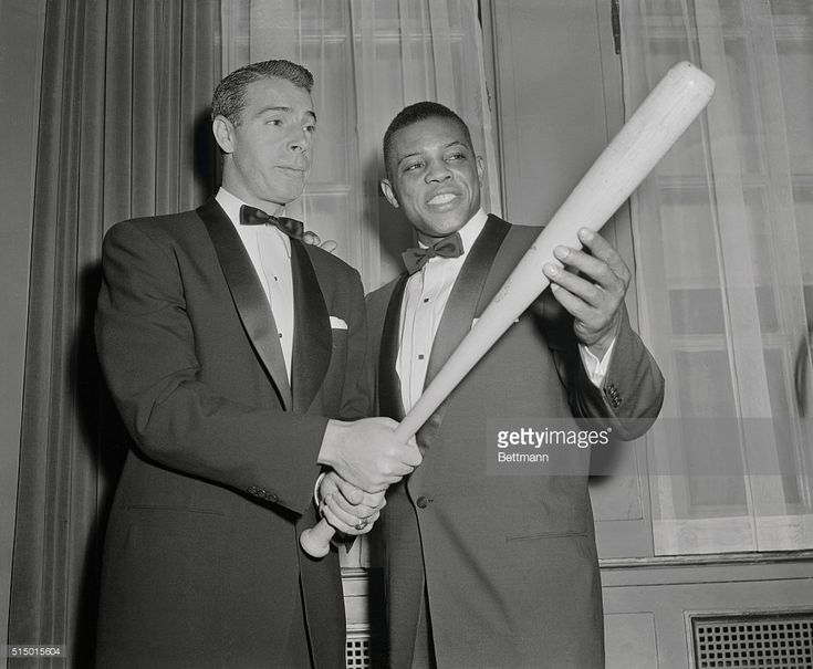 Joe DiMaggio, (L) who was just voted to Baseball's Hall of Fame, passes on a few batting tips to Willie Mays, who's a slugger in his own right. Their meeting occurred at the 32nd Annual dinner of the Baseball Writers at the Waldorf Astoria tonight. Mays, Giant outfielder and last year's NL MVP, won the Scribes' Sid Mercer Award as 'Player of The Year.' His batting average last year was .345. He hit 41 homers and has a slugging average of .667.