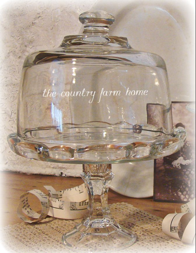 """Cake plate for $3. A pretty plate, a glass candle holder and a cheese cover """"cloche"""". Glue the bottom together with two part clear epoxy for glass. Voila! se the original blog post for details and other cake stand ideas."""