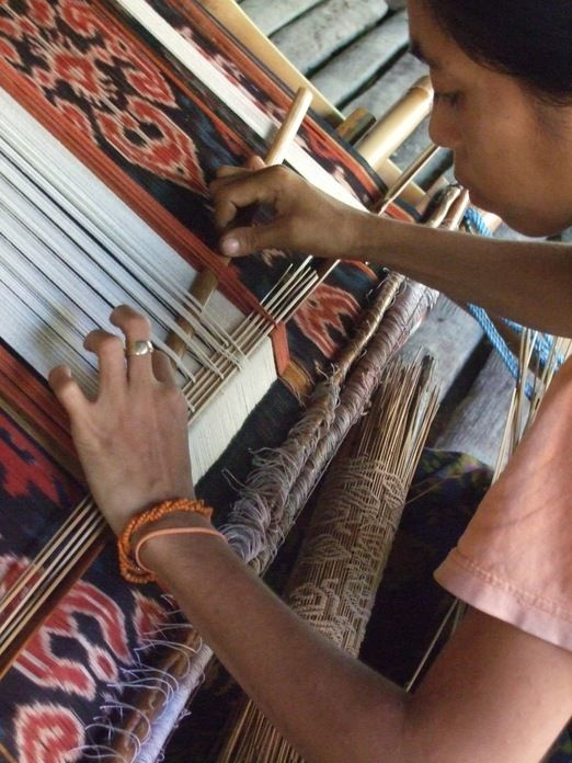 Lining up: A Sumbanese weaver works on a supplementary pattern. (Photo courtesy of Threads of Life)