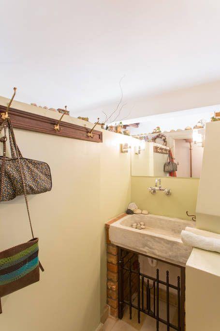 WC on ground level: marble wash basin