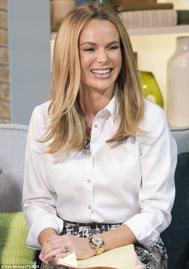 Giggly: Amanda Holden couldn't help herself as she flirted with Poldark actor Aidan Turner...