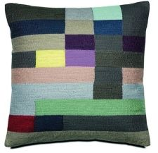 This geometric cushion with coloured squared embroidery, £69, adds contrast. Bo Concept has stores in Manchester and Liverpool