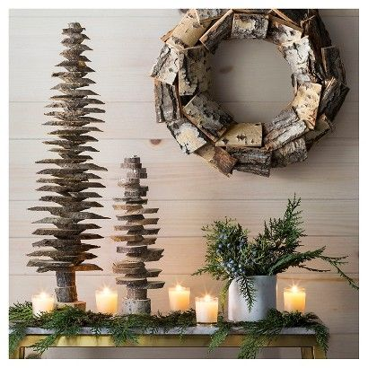 Bring the outdoors in with the Evergreen and Natural Décor Collection. In this collection you'll find Christmas trees and wreaths made of chopped pines, bouquets of green sprigs and berries and glowing votive candles for your mantle. Enjoy these winter themed decorations throughout the cold season.