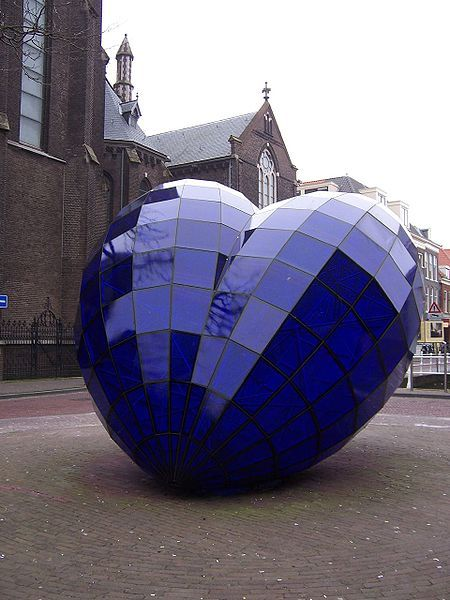 Blue heart of glass, standing out in the middle of Delft, Holland