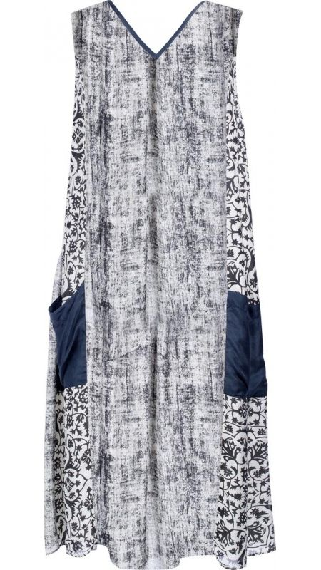 "</p> <p style=""line-height: 11.85pt; font-size: 12.16px;"">Mid-length sleeveless V neck dress in printed silk.</p> <p style=""line-height: 11.85pt; font-size: 12.16px;"">Silk binding around neckline in charcoal.</p> <p style=""line-height: 11.85pt; font-size: 12.16px;"">Centre front panel in liquen with front side panels in charcoal and liquen pattern.</p> <p style=""line-height: 11.85pt; font-size: 12.16px;"">Large pockets on lower sides of skirt panels in charcoal.</p> <p style=""line-height…"