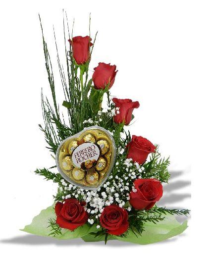 Caracola con 7 rosas y bombones ferrero rocher
