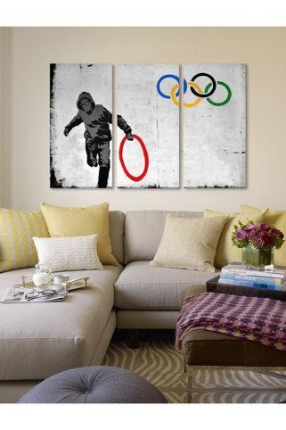 Street Art: Olympics Stolen Ring Street Art 60in X 40in 3 Piece Canvas Print