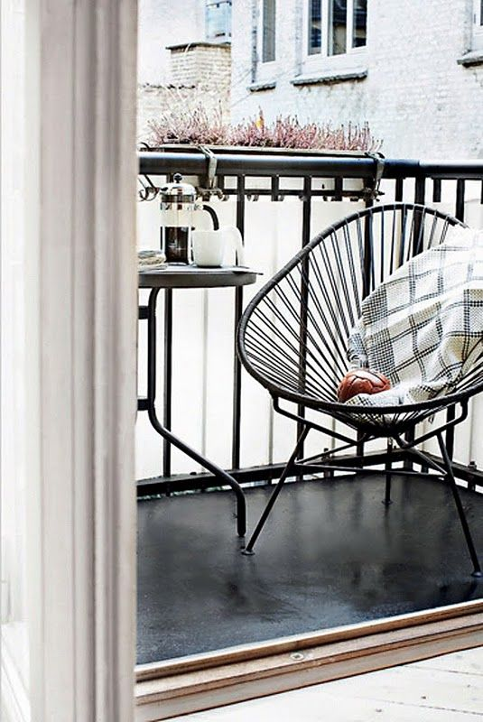 Cute balcony with an Innit Acapulco Chair (http://www.inmod.com/ch24-wegner-style-wishbone-chair.html) - great for small outdoor spaces