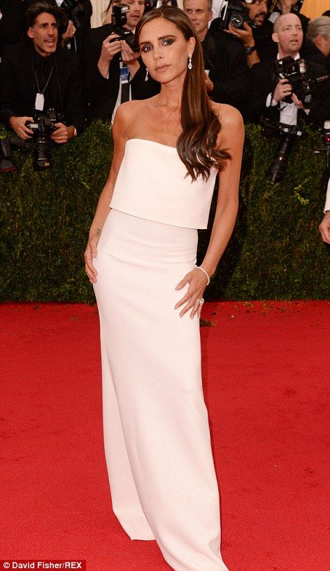 Fashion's finest: Spice Girl turned designer Victoria Beckham unsurprisingly looked amazing in a slinky white dress