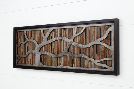 Reclaimed wood wall art made of old barnwood and rustic steel.