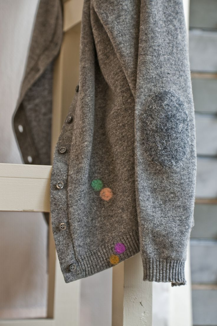 "Woolfiller deals with clothing holes in the most fabulous way. This ""fix"" of coloured dots is clever!"