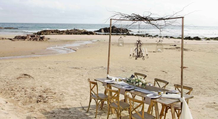Cross Back Timber Chairs, timber trestle table on the beach bohemian beach wedding reception styling