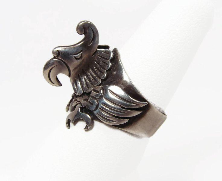 FIERCE 980 Silver Eagle Head Ring Taxco Mexico Spratling Style https://www.vintagegemz.com/listing/542378778/fierce-980-silver-eagle-head-ring-taxco $135 1930s 980 TAXCO Mexico Ring #silver #ring #antique #sterling #eagle #vintage #mexico #taxco #biker #bird #fierce #etsy