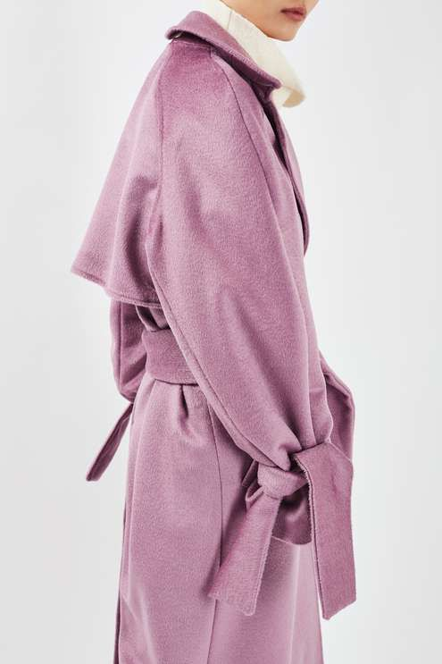 Choose colour to revamp your winter wardrobe in this stunning lilac coat by Boutique. In a wrap style, it comes with a waist belt, tie detail at cuffs and a split to the back. A statement piece, style over casual grey and ivory hues for a pretty-pastel look. Made in Britain. By Boutique. #Topshop