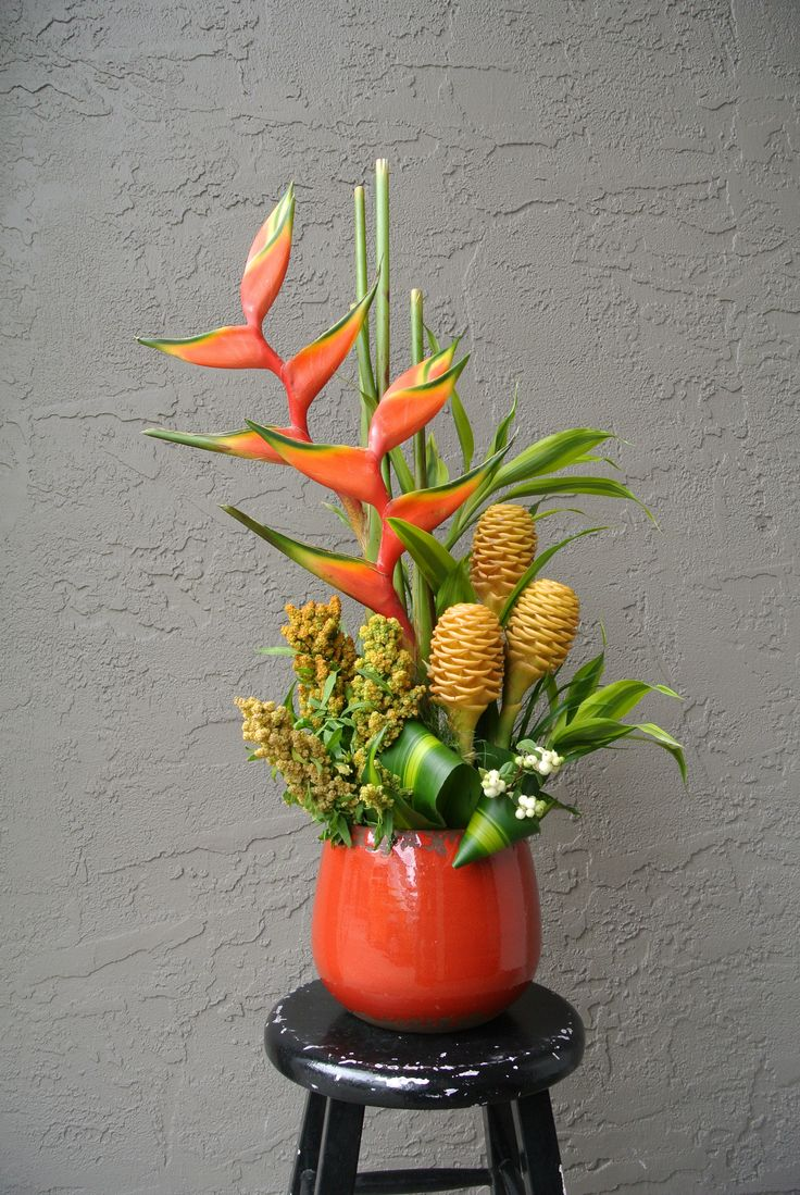 Bright summery arrangement with beehive, Heliconia,quinoa