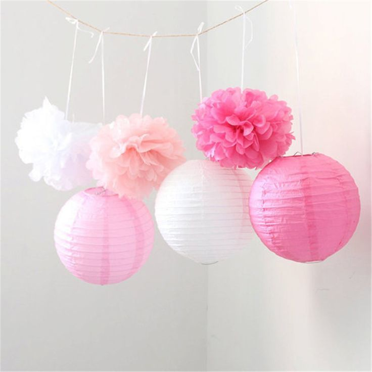 paper lanterns and tissue paper pom poms sure makes a good home decoration! Just make sure to use beautiful and matching colors
