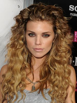 Quit fighting with your flat iron and find a cute haircut that lets you rock your curls. Check out these celebrity hairstyles to see what works best for your 'do