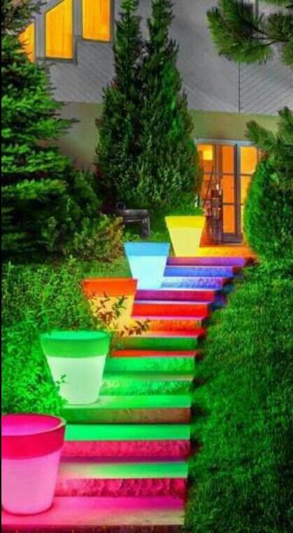 Bright almost neon colored outside stairway. I would love to know if the house is as colorful inside as outside...