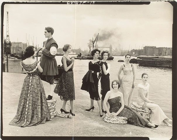 Models and a 'Doggetts Coat and Badge' gentleman at the Rotherhithe docks, Vogue September 1957. Dressed by members of IncSoc. Photography by Norman Parkinson