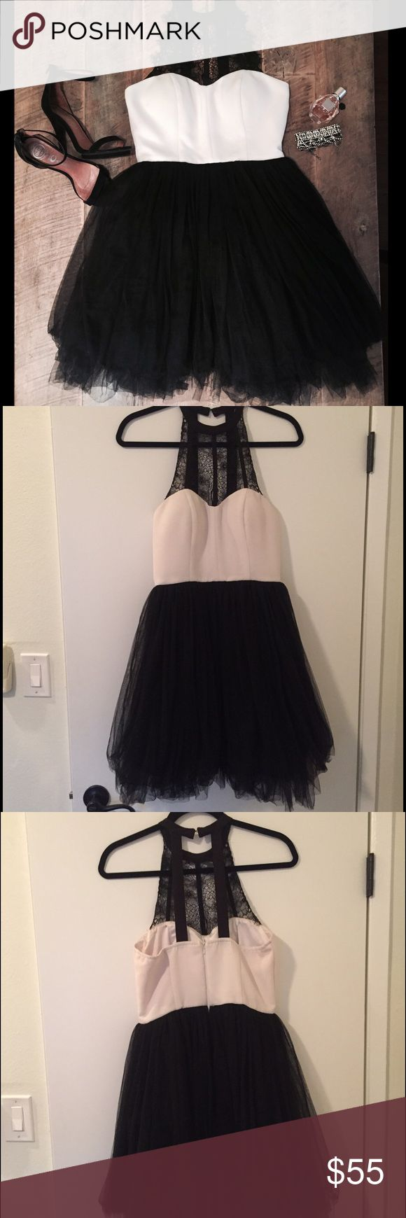 Party Dress Great for a fun event! Looks awesome on different body types! It has been worn once and dry cleaned. Halter with lace, fitted bodice, and tuelle skirt. Party/cocktail tuelle dress 🎉 awesome for a wedding or even prom. a.  drea Dresses