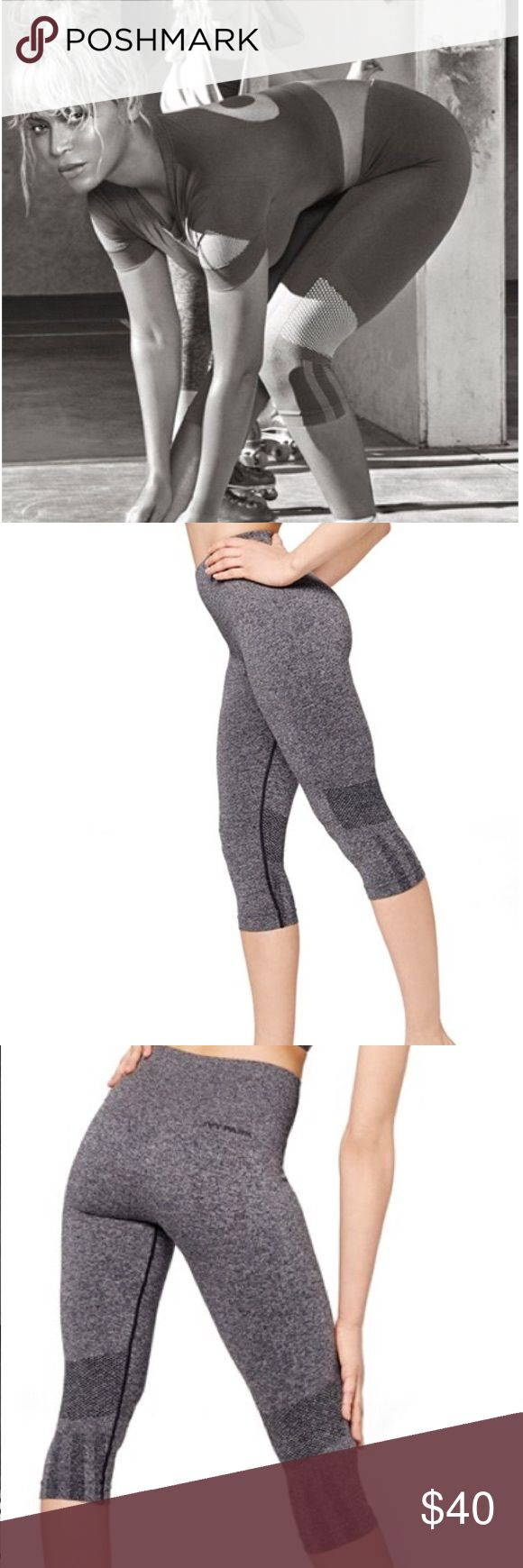 """Ivy Park (Beyoncé) Seamless Capri Leggings Capri-length w/ ventilating knit mesh at knees made from a technical stretch fabric with sweat-wicking & quick-drying properties. A compression-ribbed waist supports and conforms to the body and can be folded down for a low-rise fit that reveals a stripe accent 72% polyester, 24% nylon, 4% elastane. Machine wash cold, dry flat. Inseam 18"""". Waist 11"""" across laying flat unstretched. Never worn, I find always go for my black ones,so these are still…"""