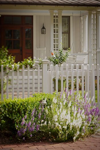 """Love the fence and flowers in front. pretty arbored trellis """"columns"""" on porch...  West Wilson Palmetto Bluff"""