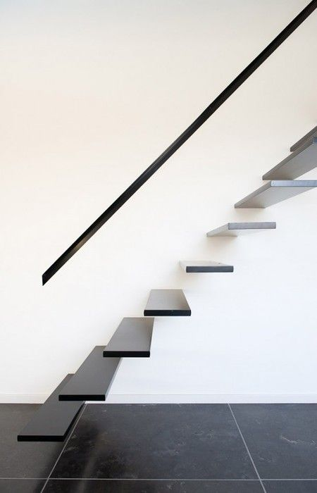 Minimal stairs. Floating treads with open risers appear to defy gravity.