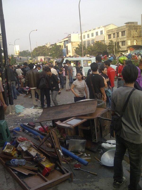 A speedy mini bus hit a food-street vendor.  Jakarta...oh...Jakarta (by TMC Polda Metro Jaya)