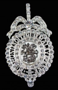 Order of the Garter Queen Victoria's sash badge (Lesser George).  The Order of the Garter is the highest English order of Chivalry, and is one of the most important orders in the world.    The centre is a brown cameo of St. George attacking the dragon with a sword. This is encircled by an open garter with an inner boarder of 20 brilliants and an outer boarder of 31 brilliants.
