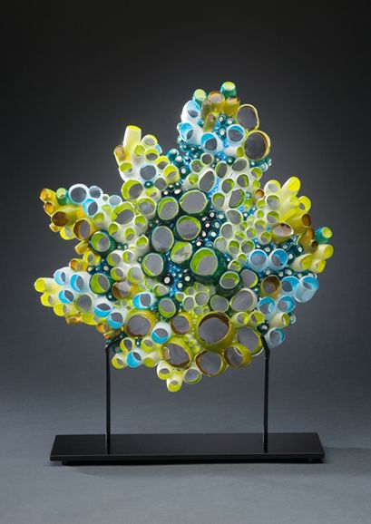 """Marsha Blaker-DeSomma FIELD STUDY 2010 blown, fused and cut glass with metal stand 13""""h (w/base 16.5""""h) x 13""""w x 4""""d (depth of base) $3,700 """"The organismic detail and intricacy in my work are inspired by my observations  of nature.  Networks, intertwined webbings and myriad channels are visible in microscopic inspection of the organic cellular level as well as in a sattelite view of the Great Amazon Basin.  Fundamentally, all life is liquid and has been shaped by fluid systems."""""""
