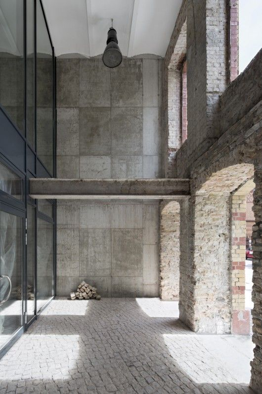 The Factory Berlin / Julian Breinersdorfer Architecture From an old factory resulting in topography forms a village-like arrangement of white volumes, which are home to clusters of small start-ups, gathered around a central outdoor plaza on the fifth floor.
