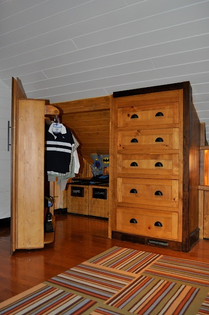 attic room storage. WOW! We may need this for the girls' future room! :)