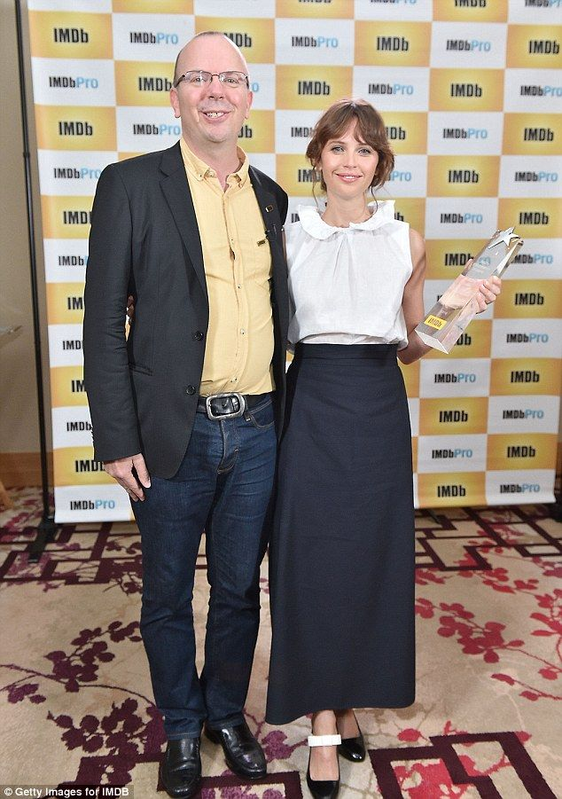 Honour: IMDb Founder & CEO Col Needham presents Felicity Jones with the IMDb…