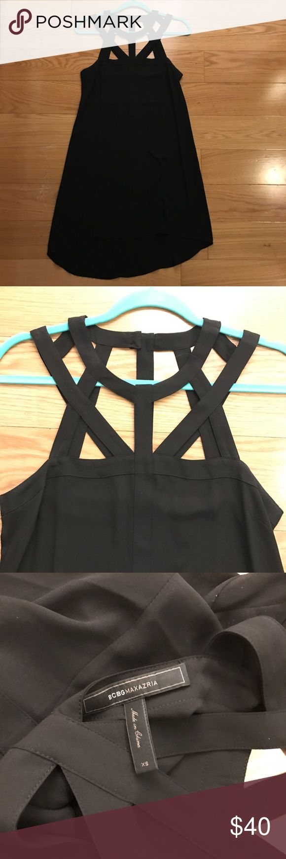 Strappy/Cage Top BCBGMAXAZRIA Dress Like new!! Only worn once. Black BCBGMAXAZRIA dress with strappy/cage top detail. Sexy LBD. Great for a night out or cocktail hour! Would definitely recommend wearing a slip under this as it's kind of sheer BCBGMaxAzria Dresses