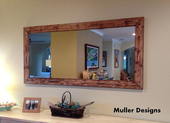 Wooden mirror frames designed and handmade by me Alexander Muller. I'm a German designer that traveled and studied in different countries, but now I'm living in Los Angeles. My designs are unique and made out of wood, I design the shape and let the wood reveal its natural 3D texture.  Every piece of art designed by me has a stainless steel plate engraved with my signature and date when they were finished. . Made in USA Made from all-new materials. Wood mirror size 70x35 Color: Natural